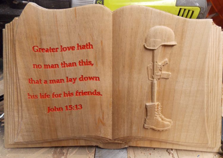 Open book with Lest We Forget CNC