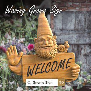 Waving gnome sign in garden